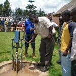 Trainees testing a ropepump on a borehole of 25 m deep